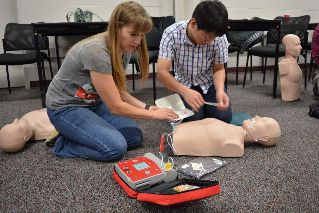 C-CERT members practice using an AED