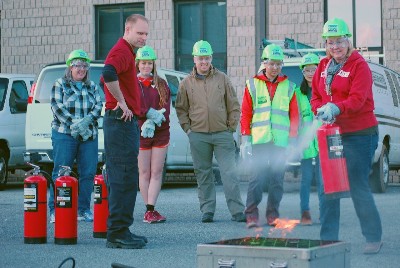 C-CERT team practices uses fire extinguishers to put out fire